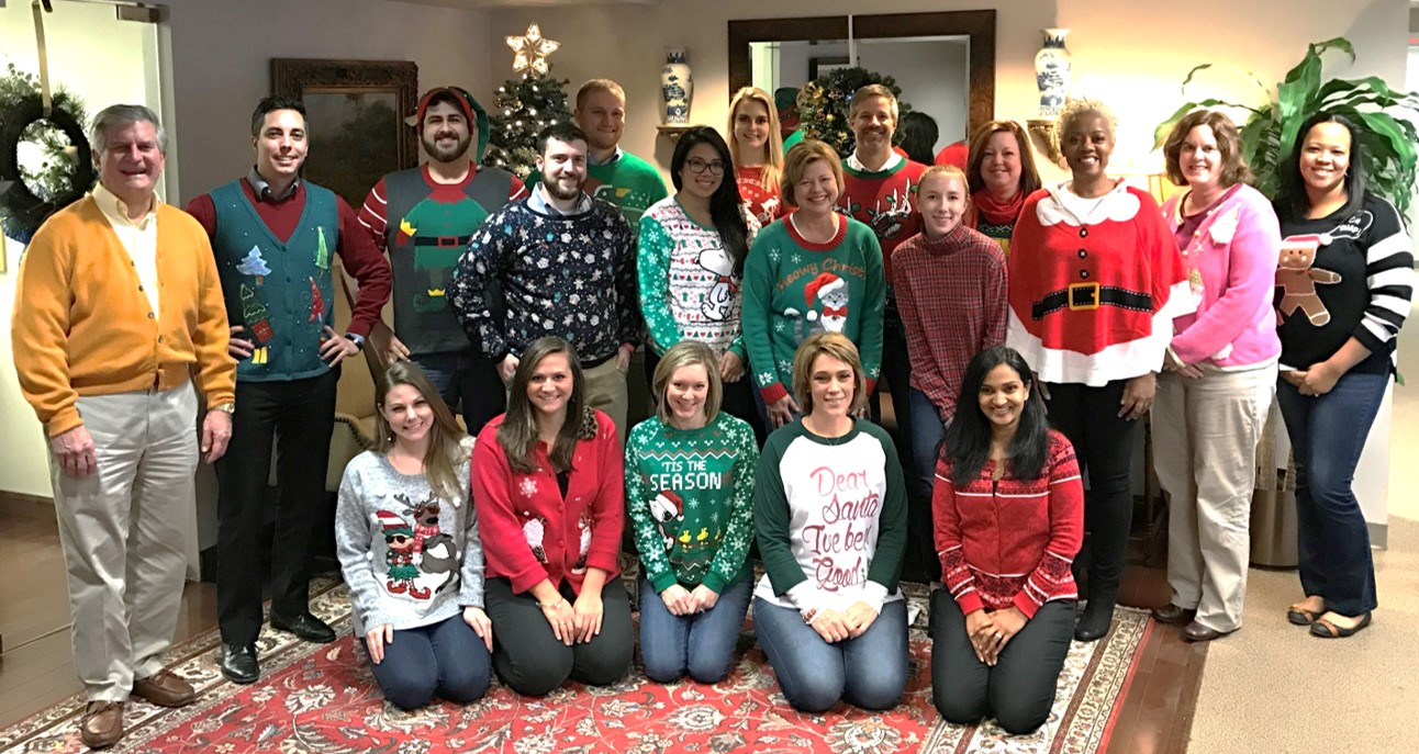 A few of our team memebers showing off their tacky Christmas sweaters!