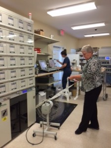 Amanda Ruinato, pharmacy technician, and Cindy Dent, RPh, director of operations, demonstrate the capabilities of the new packaging system.