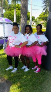 Guardian Southeast Florida employees Charmaine Munnings, medical records supervisor; Joyanne Cadet, billing specialist; and Sommer O'Neal, medical records technician, sport pink tutus at the race.