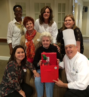 Pictured left to right: Back Row - Carla Gainer, RN, health and wellness director; Bonnie Warren, resident program coordinator; Ali Wiggins, account manager, Guardian Pharmacy; Kelli Mercer, executive director. Front Row - Aileen Griffin, sales and marketing manager; Jane Dunham, resident of ClareBridge of Tallahassee; Danial Unruh, executive chef.