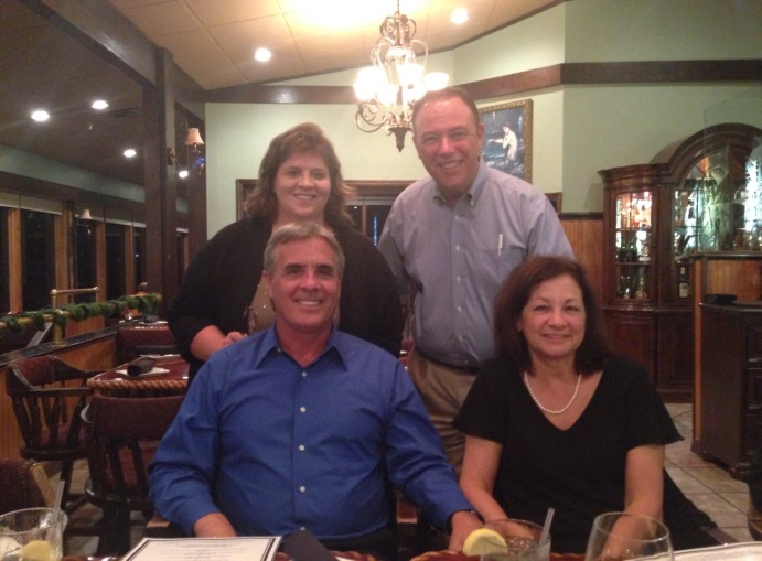 Mike and Donna Klein (bottom row) and Mary Crowe and Alan Traster (top row) celebrate their new partnership.