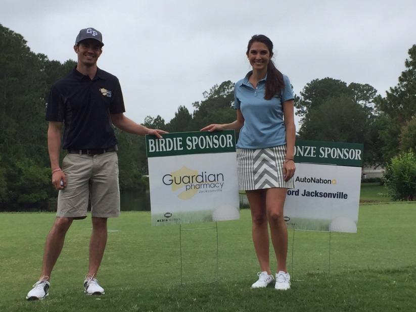 Jerry Talarico, client service relations manager, and Georgina Leininger, director of marketing, prepare to tee off at the golf tournament.