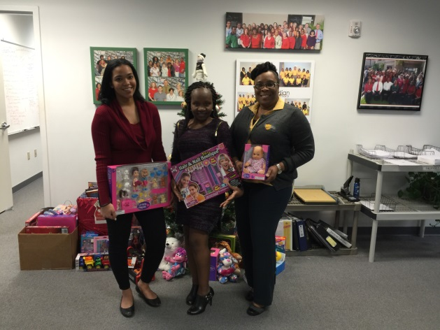 Rachelle Ferra, Lunise Eugene, and Charmaine Munnings representing three of the organizations receiving toys.