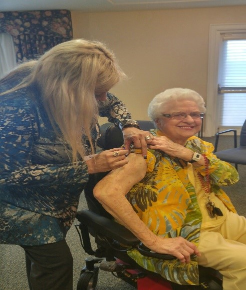 Brooke Gambrel, RN, Nurse Account Manager/Clinical Care Specialist giving flu shots at Somerby Independent Living in Mobile, AL.