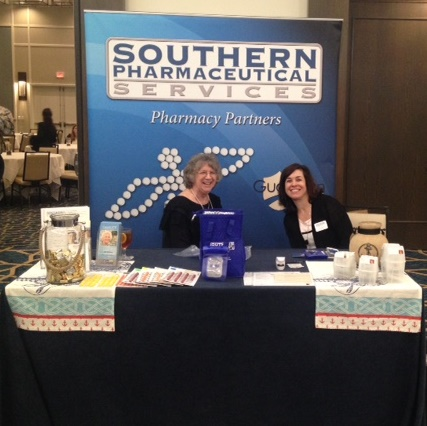 Anita Pritchett, consultant pharmacist, and Tess Davis, director of business development, at the SPS Booth during the 2015 Spring ALAA Conference in Destin, Florida.