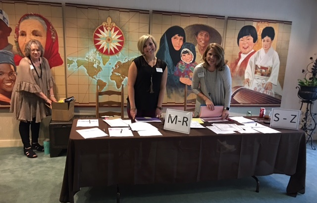SPS staff preparing the registration area for attendees of the Teepa Snow Conference. From l to right: Anita Pritchett, consultant pharmacist; Alicia Tibbs, account manager; and Wendy Kallaher, director of clinical support.