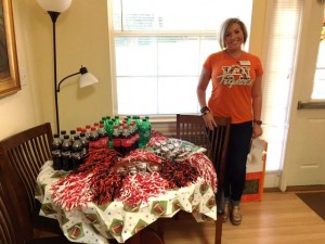 Alicia Godwin Tibbs, Account Manager is shown with the table of  Snacks and give away items provided by SPS