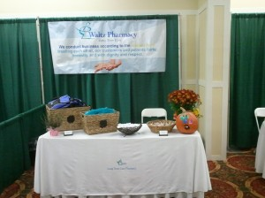 Waltz Pharmacy booth with complimentary lunch bags, ChapStick, hot/cold compacts and candy.