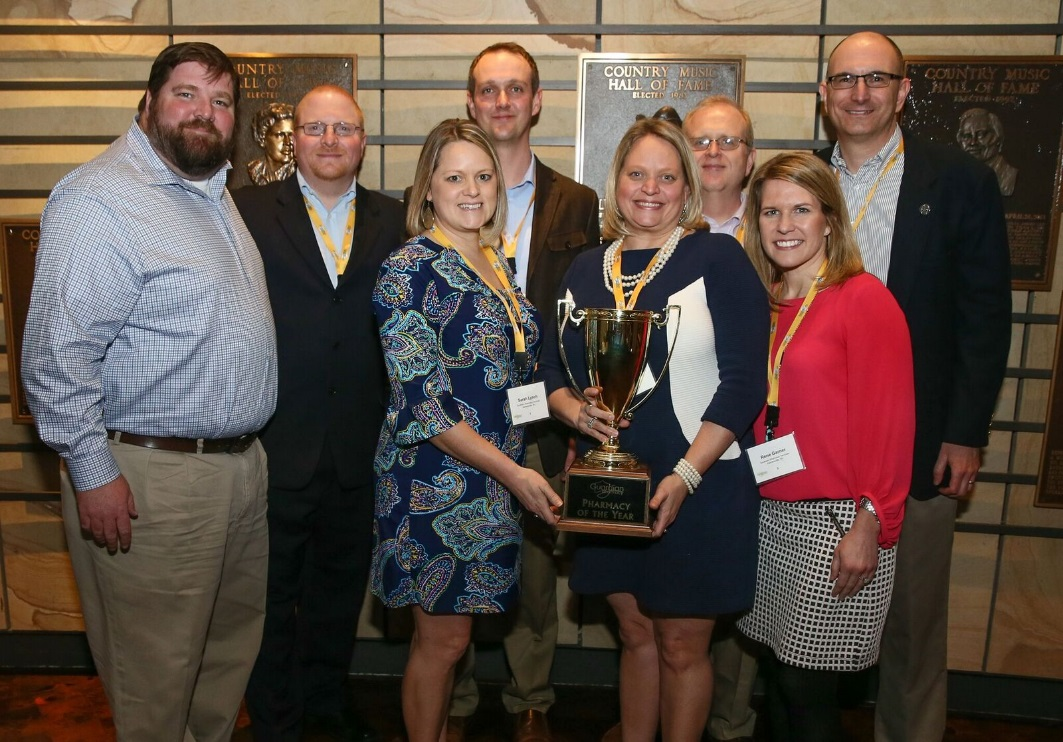 """2016 """"Pharmacy of the Year"""" Winners—Southern Pharmacy Services (Kernersville, NC).  From l: Chad Terry (President), Joel Noped (Director of Operational Support), Sarah Lynch (Director of Sales), Brian Dufour (Director of Operations), MaryBeth Terry (President), Taylor Driscoll (Director of IT), Rene Gardner (Director of Finance), Cecil Davis (Assistant Director of Operations/Fulfillment Supervisor)"""